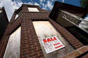 A foreclosed home is shown in Chicago June 29, 2010. It may not make the blood boil like murder or rape, but mortgage fraud is a crime that cost an estimated $14 billion in 2009 and could be hampering an already fragile recovery in the housing market. The FBI has been fighting back, assembling its largest ever team to fight it. They have their work cut out for them, though, as a tsunami of foreclosures is making classic scams easier and spawning new ones to boot. Photo taken June 29, 2010. To match Special Report HOUSING-USA-FRAUD/  REUTERS/John Gress (UNITED STATES - Tags: CRIME LAW BUSINESS) - RTR2HCLL